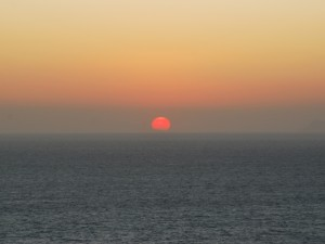 Closeup of the setting sun  in Santorini
