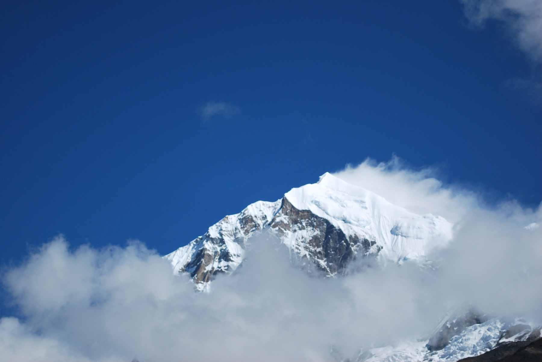 One of the five peaks of Kanchenjunga covered in clouds