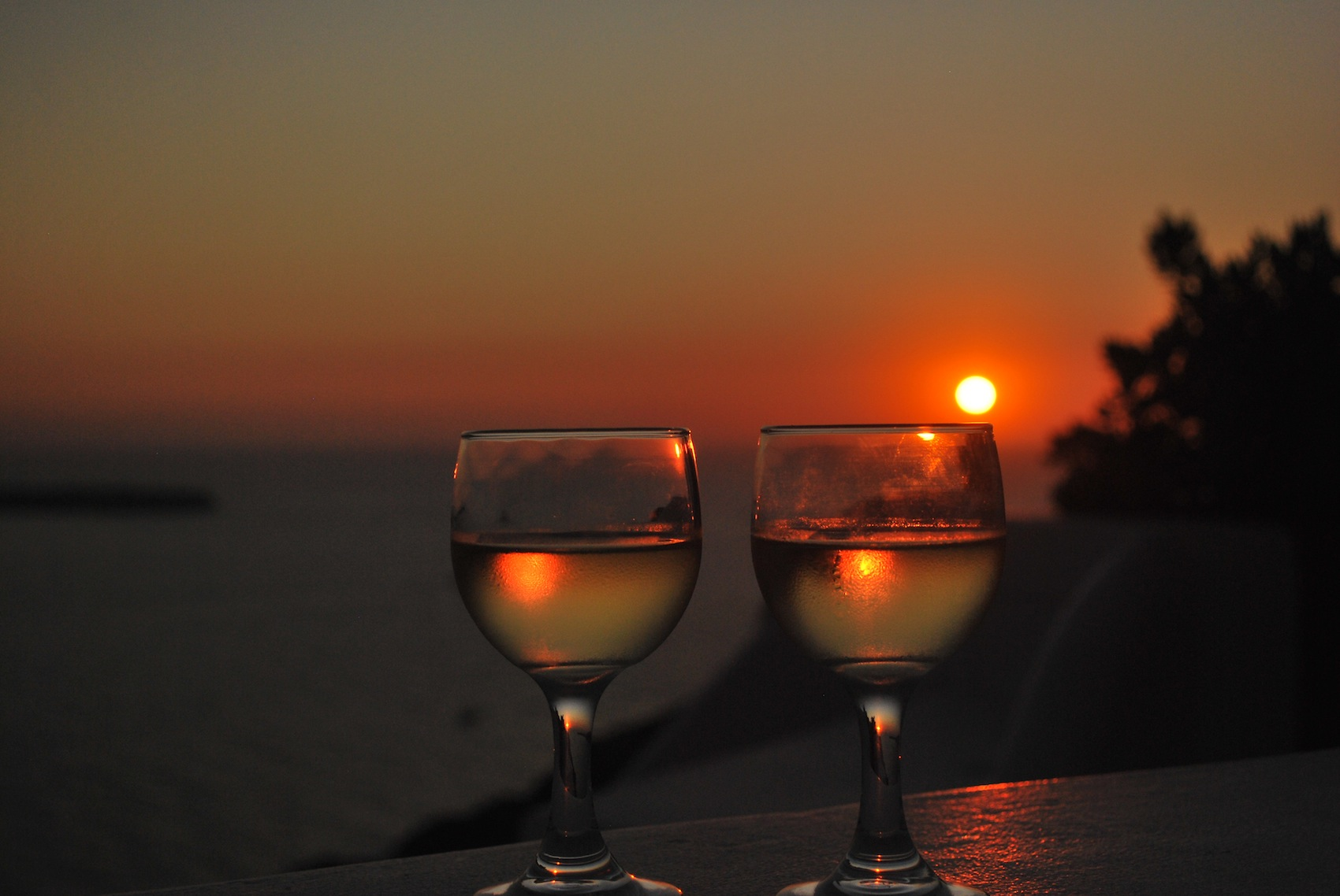 Wine appears  with the setting sun in Santorini